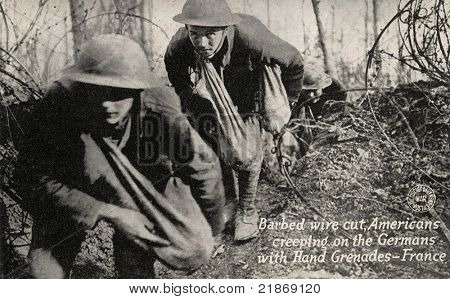 Barbed Wire Cut - Early 1900's WWI postcard depicting Americans going through cut barbed wire with bags of grenades toward Germans.