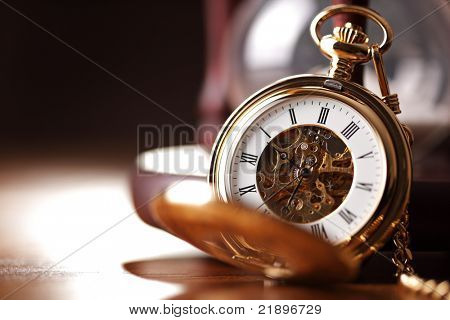 Vintage pocket watch and hour glass or sand timer, symbols of time with copy space