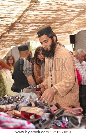 MERTOLA, PORTUGAL - MAY 23:  Festival Islamico de Mertola (islamic fair) men selling some traditional objects in the streets of the islamic fair May 23, 2009 in Mertola, Portugal.