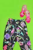 floral pants with ,pink shoes for women-green background