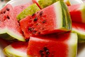 Juicy watermelon. Background of brightly lit watermelon slices.