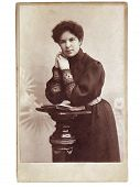 stock photo of early 20s  - Vintage portrait of woman early 20 century on background - JPG