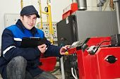 pic of hvac  - maintenance repairman engineer of heating system equipment in a boiler house - JPG