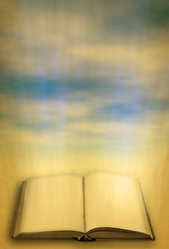 foto of holy-spirit  - open holy book against heaven focus is set in foreground - JPG