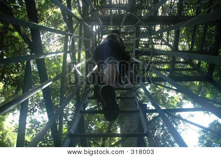 Woman Climbing Tower Ladder