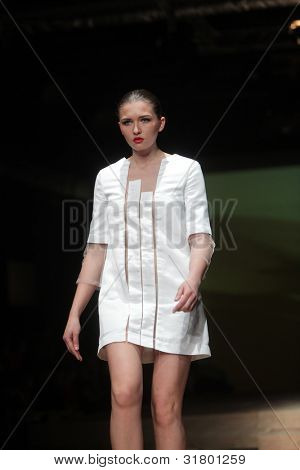 "ZAGREB, CROATIA - MARCH 24: Fashion model wears clothes made by Hippy Garden on ""CRO A PORTER"" show on March 24, 2012 in Zagreb, Croatia."