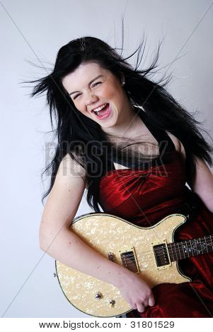 Singing girl with guitar