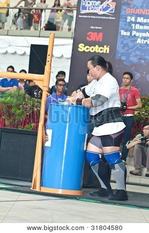 TOA PAYOH, SINGAPORE - MARCH 24 : Contender for Strongman Keith Wong in his 300kg yoke walk in the Strongman Challenge 2012 on March 24, in Toa Payoh Hub, Singapore.
