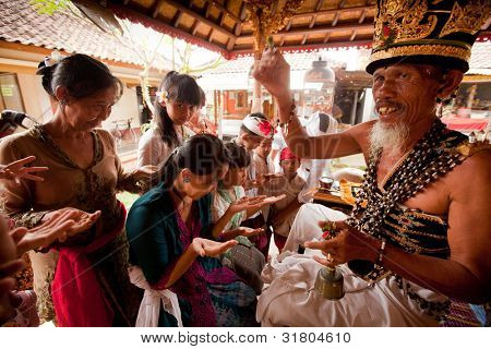 BALI, INDONESIA - MARCH 28: Hindu Brahmin during the ceremonies of Oton - is the first ceremony for baby's on which the infant is allowed to touch the ground on March 28, 2012 on Bali, Indonesia.
