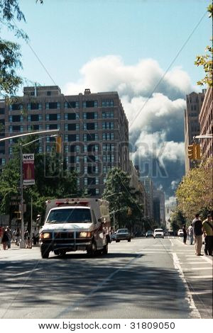 NEW YORK - SEPTEMBER 11: An ambulance moves away from the area known as Ground Zero after the collapse of the Twin Towers on September 11, 2001 in New York City.