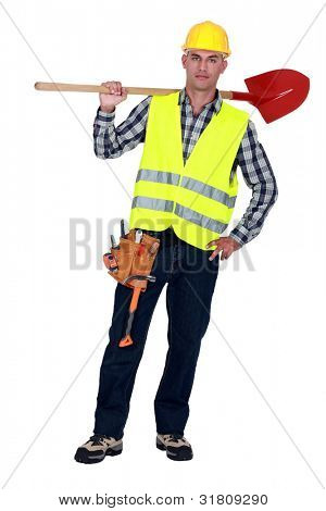 Labourer carrying a spade