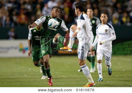 CARSON, CA. - April 23: Portland Timbers D Rodney Wallace #22 & Los Angeles Galaxy F Juan Pablo Angel #9 during the MLS game between the Timbers & the Galaxy on April 23 2011 at the Home Depot Center.