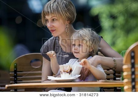 mother and little daughter eating ice creams