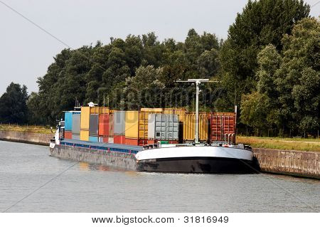 Containers in a barge near Antwerp harbor