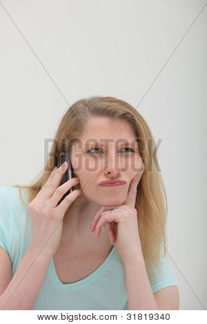 Sceptical Woman On Mobile Phone