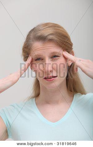 Blonde Female Struggles With Headache