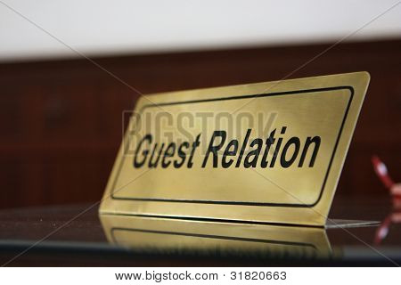 Close Guest relation tablet on reception desk