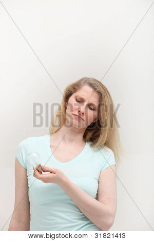 Thoughtful Woman With Light Bulb