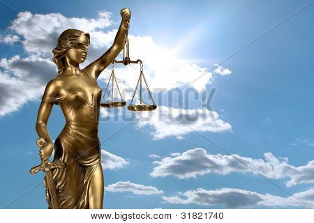 Lady of Justice on sky background