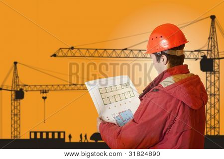 Project architect checking blueprints of a new building
