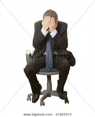 A scared businessman in a chair isolated on a white background