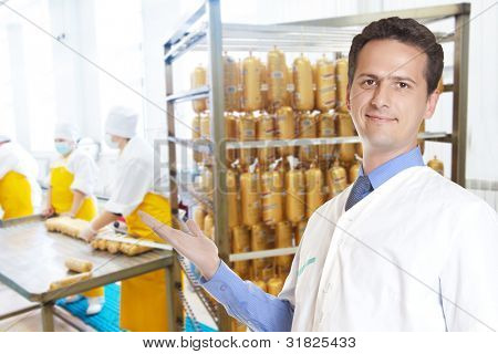 portrait of male seller sausage looking at camera