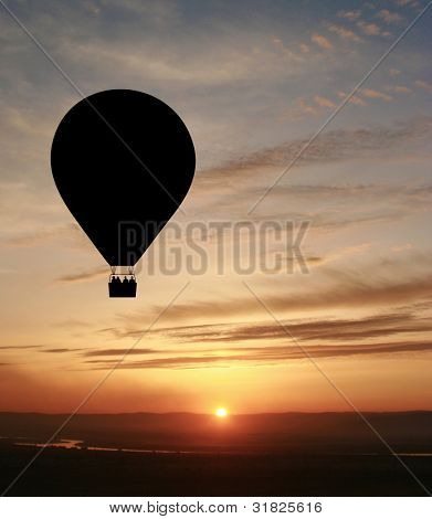 Hot air balloon with setting sun