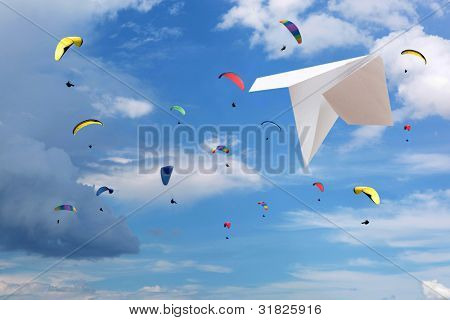 Paraglider soaring in a blue sky