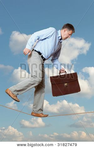 Businessman rope-walker