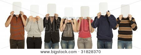 Group people with the painted mask on the sheet of paper over his face isolated on white