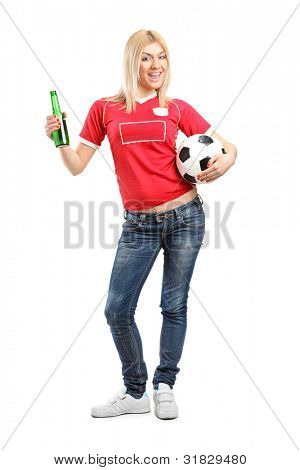 Full length portrait a blond female fan holding a beer bottle and football isolated on white background