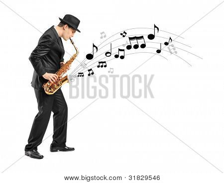 Full length portrait of a man playing on saxophone and notes coming out isolated against background