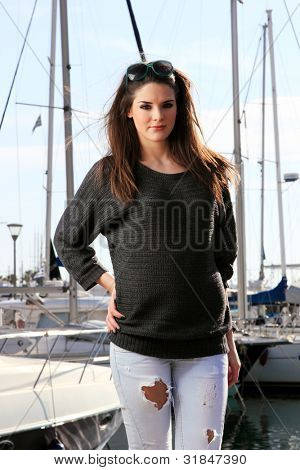 Young woman at the port of Piraeus Greece