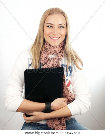 Happy young student girl holding notebook, studying in university or high school, modern education, cute blonde teen girl smiling, successful people concept
