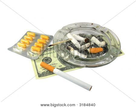 Cigarette, Money, Ash-Trash, And Drugs Isolated On White