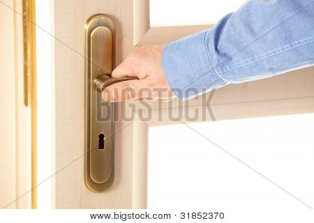 Male hand on handle, opening or closing door