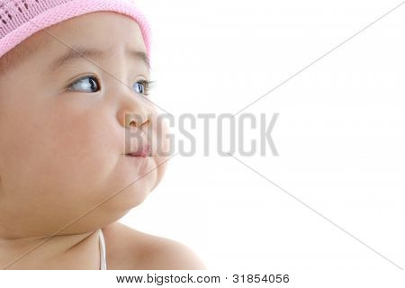 Close up beautiful 10 month old pan asian baby girl in pink flower hat