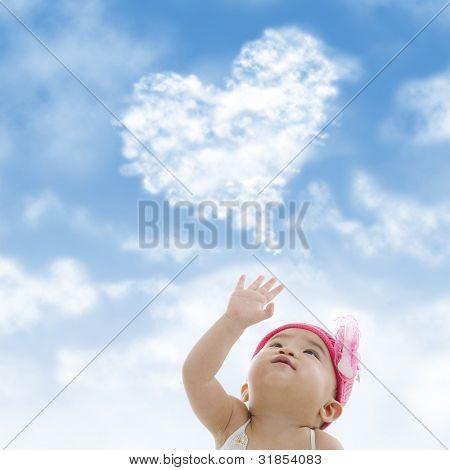 Baby girl hand towards sky