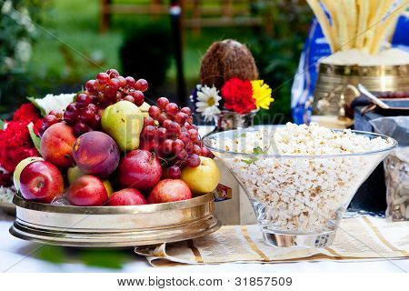 bowl of fruit on a banquet table with popcorn