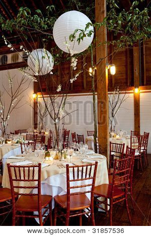wedding tables set for fine dinning during a catered event