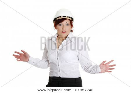 Businesswoman in white helmet being shocked. Isolated on white