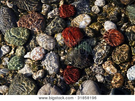 Colorful stones under water