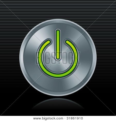 Round metal start button with green light on dark background. Rasterized version