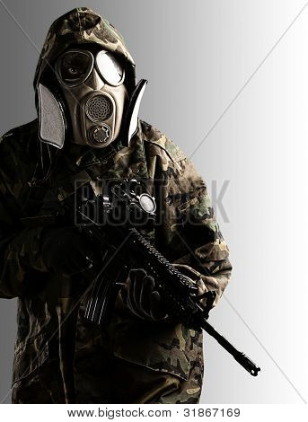 portrait of soldier with mask and rifle against a black and white background