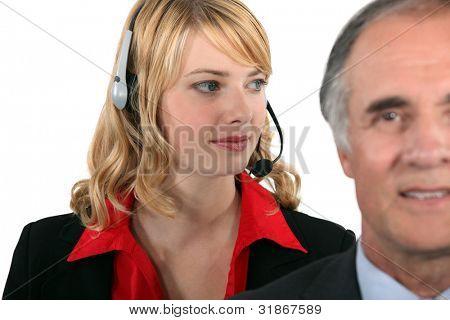 Attractive secretary standing behind her boss