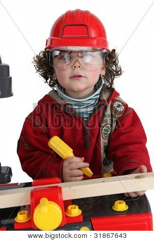 Child playing builder