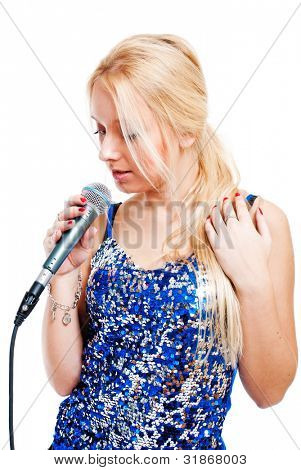 Pretty young woman singing in microphone isolated on white background