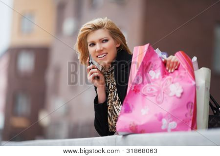Young shopper on the phone