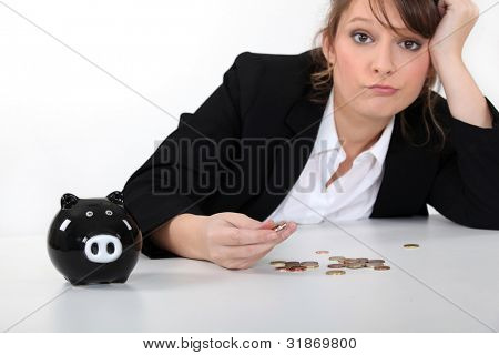 Woman counting coins