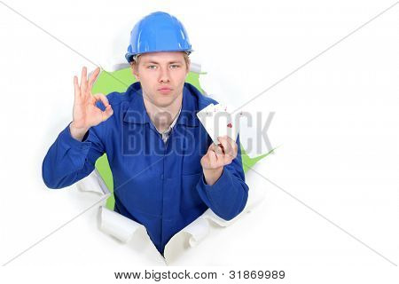 Tradesman giving the a-ok sign and holding up cards